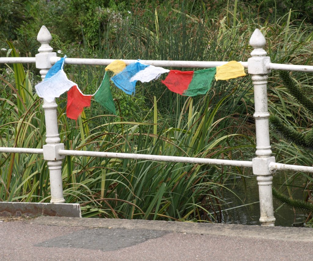 Prayer flags on Sheene Mill bridge on the river Mel. Photo by Bruce Huett