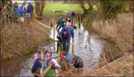 The River Mel Restoration Group at work for people and wildlife. Photo from the River Mel Restoration Group