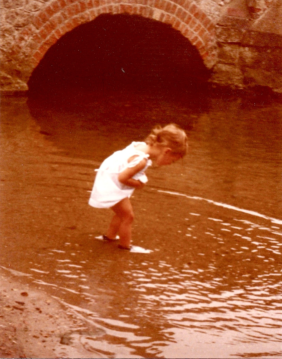 Chloe Fitzgerald, aged 3, at play in the River Mel